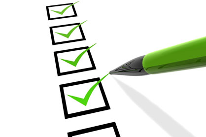 list of checkboxes with green pen adding check marks