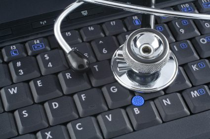 stethoscope on top of a laptop keyboard