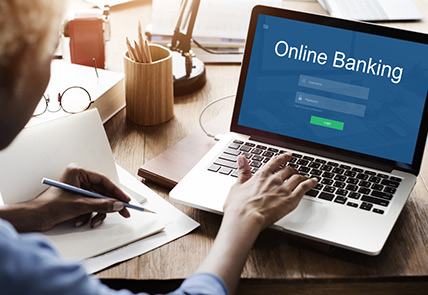women attempting to fill out login information on online banking webpage