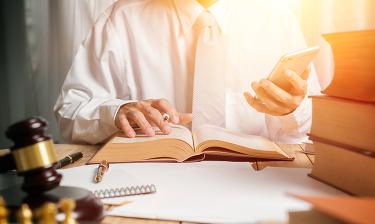 person working around legal books and gavel