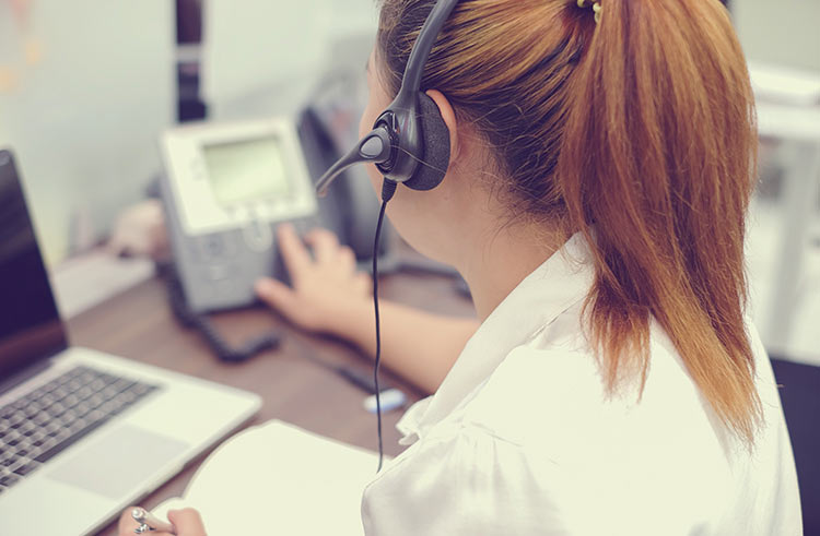 women with headset on the phone
