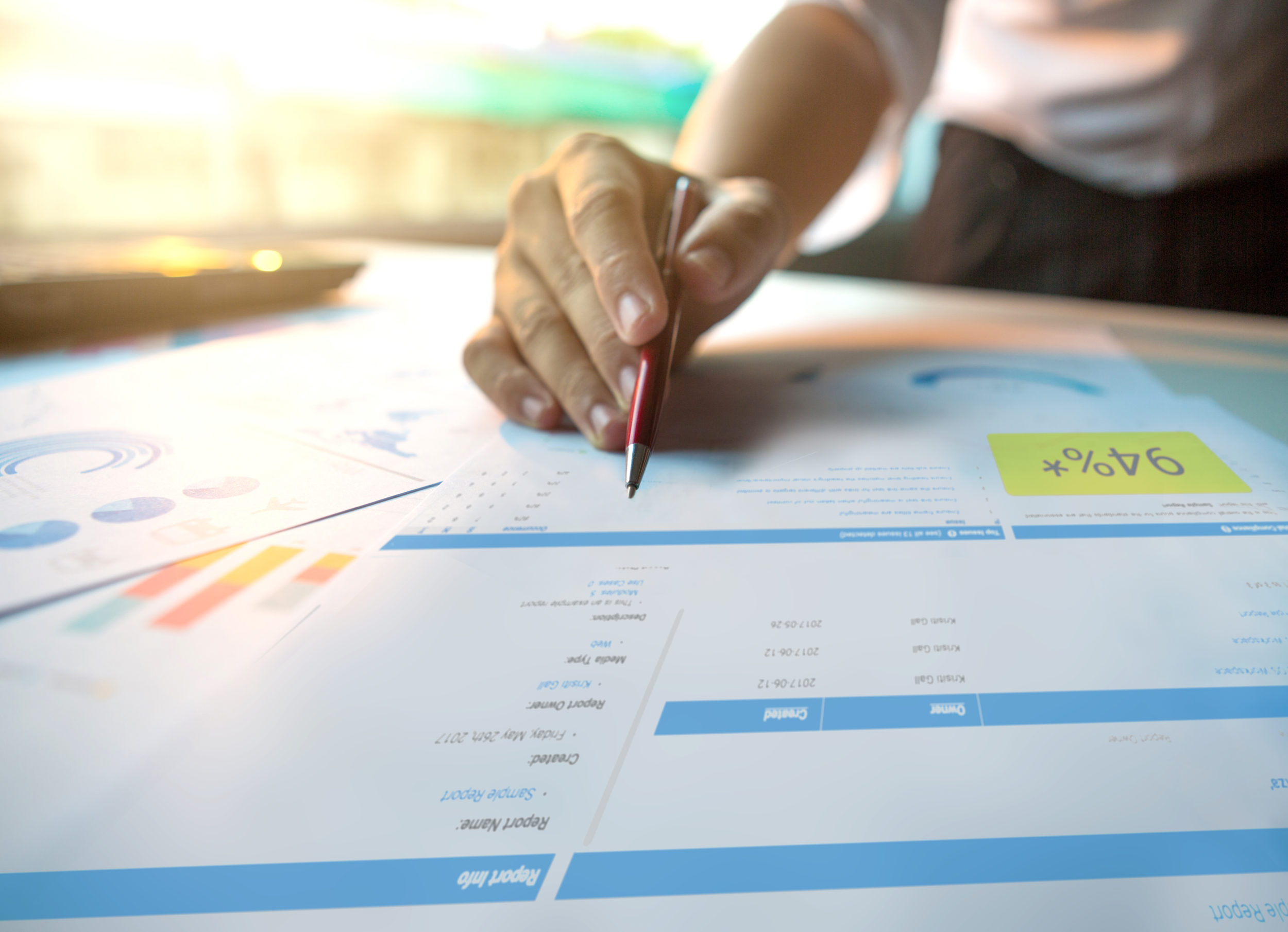 close up of a person looking at printed document of a sample report