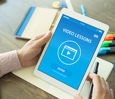 User holding iPad with video lesson