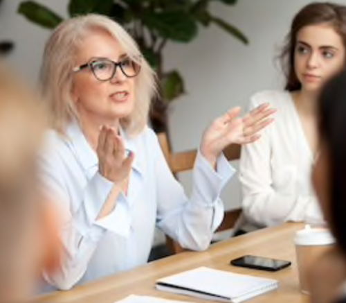 Woman in a business meeting, talking and gesturing with her hands