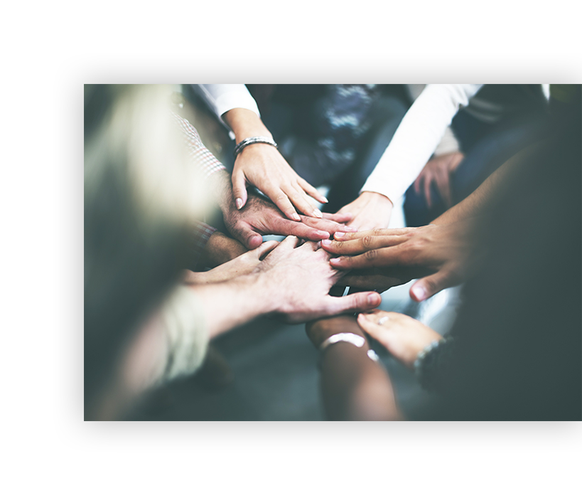team of hands in a circle