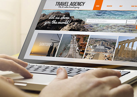user booking vacation online on a laptop