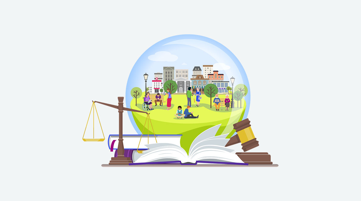 A crystal ball sits atop a pile of legal books. Inside the ball is an image of a happy small town and its residents. In the foreground are the scales of justice and a judge's gavel.