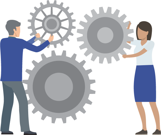 Two people adjusting giant gears